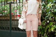 With white shirt, floral blazer, hat and white shoes