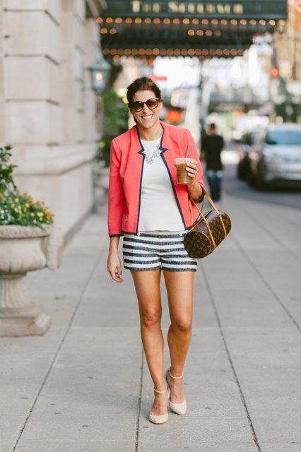 With white shirt, jacket, printed bag and beige shoes