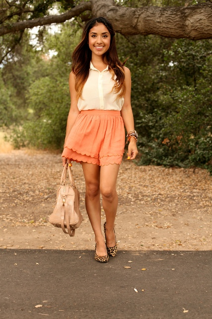 With white shirt, leopard flats and beige bag