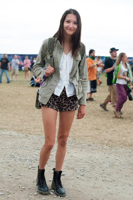 With white shirt, olive green jacket and black boots