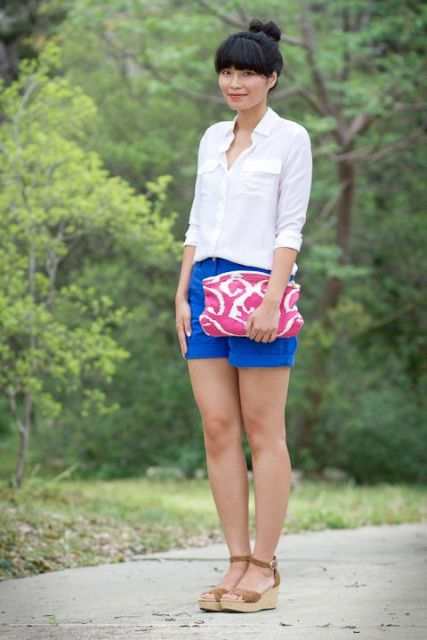 With white shirt, pink clutch and platform sandals