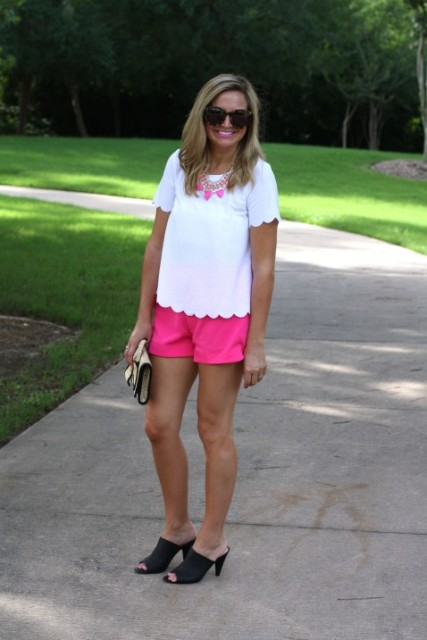 With white shirt, pink necklace and black mules