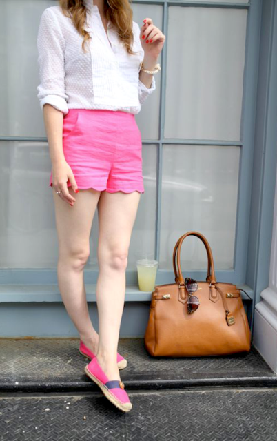 With white shirt, pink shoes and brown leather bag