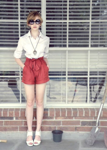 With white shirt, white sandals and sunglasses