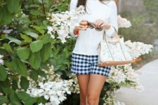 With white shirt, wide brim hat, printed bag and orange shoes
