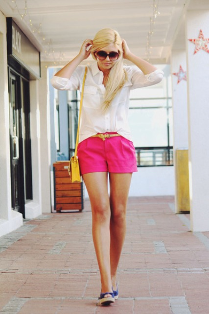 With white shirt, yellow mini bag and blue flats