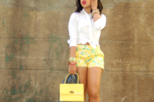 With white shirt, yellow small bag and yellow sandals