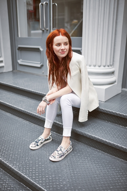 With white skinny pants and cream blazer