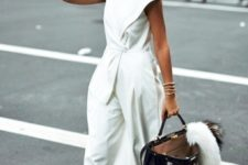 With white sneakers, sunglasses and big tote