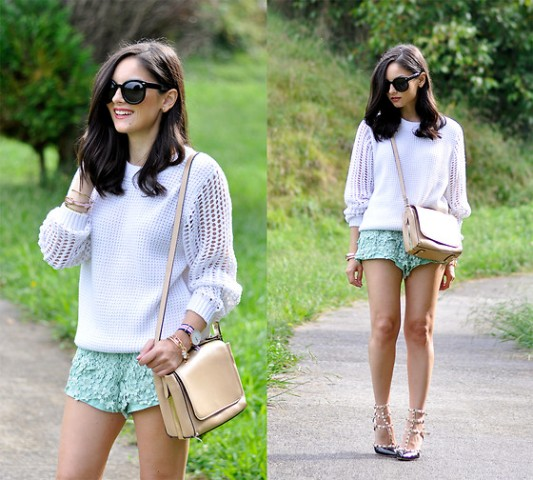 With white sweater, beige crossbody bag and heels
