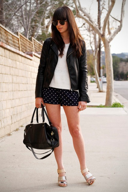 With white t-shirt, black jacket, black bag and metallic shoes