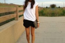 With white t-shirt, clutch and nude sandals