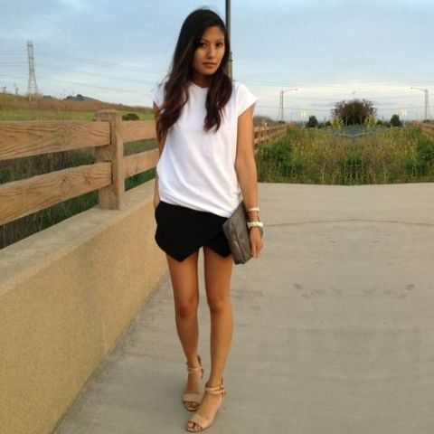 With white t shirt, clutch and nude sandals