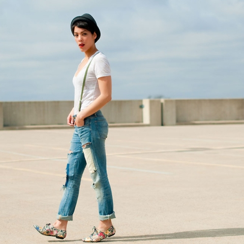 With white t-shirt, cuffed jeans and hat