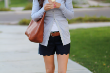 With white t-shirt, gray cardigan, brown tote and slide sandals
