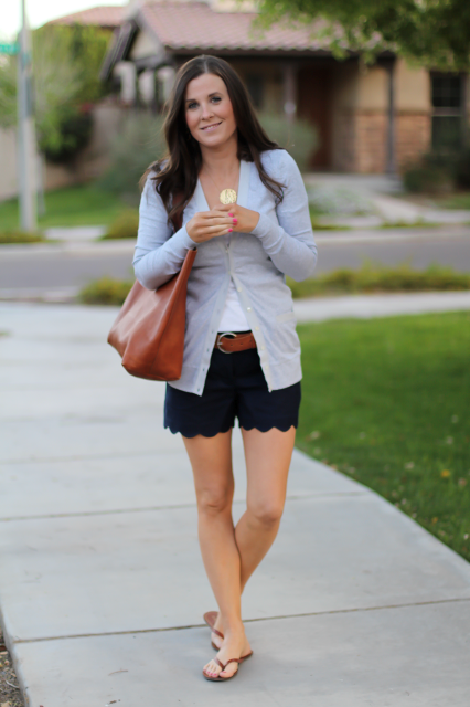 With white t shirt, gray cardigan, brown tote and slide sandals