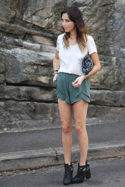 With white t-shirt, printed clutch and black cutout boots