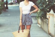 With white t-shirt, straw bag and metallic shoes