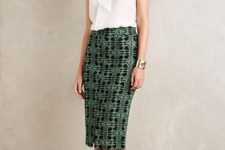 With white top and printed midi skirt