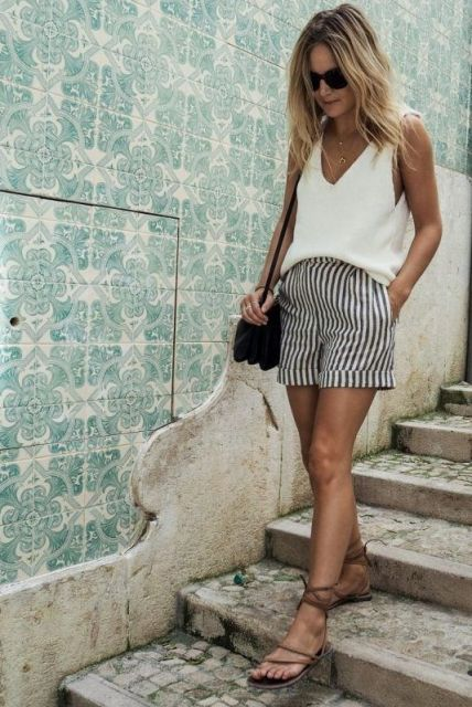 With white top, black bag and lace up sandals