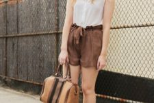 With white top, brown shoes and brown bag