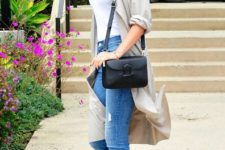 With white top, light gray long shirt, jeans and black bag