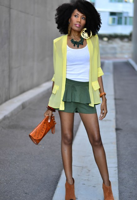 With white top, light yellow blazer, orange clutch and brown boots