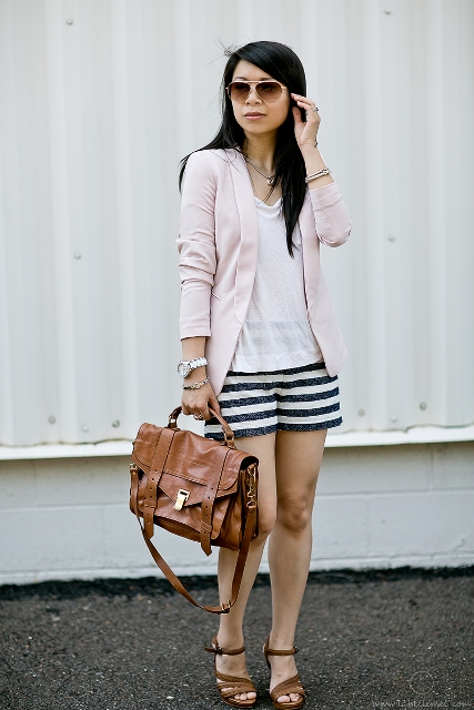 With white top, pale pink blazer, brown shoes and bag