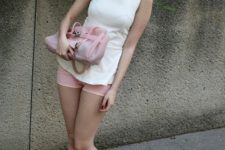 With white top, pink bag and sandals