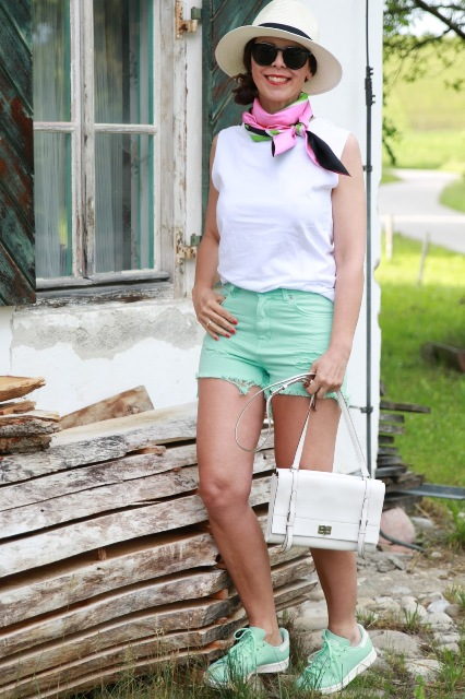 With white top, printed scarf, white bag, mint sneakers and hat