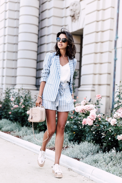 With white top, striped blazer, platform shoes and mini bag