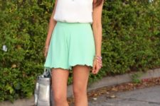 With white top, white sandals and metallic bag