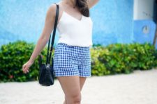 With white top, white sneakers and black bag
