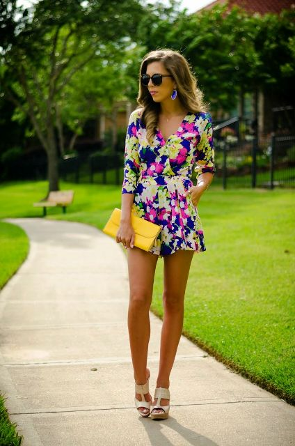 With yellow clutch and beige heels