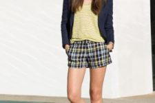 With yellow striped shirt, navy blue blazer and metallic sandals
