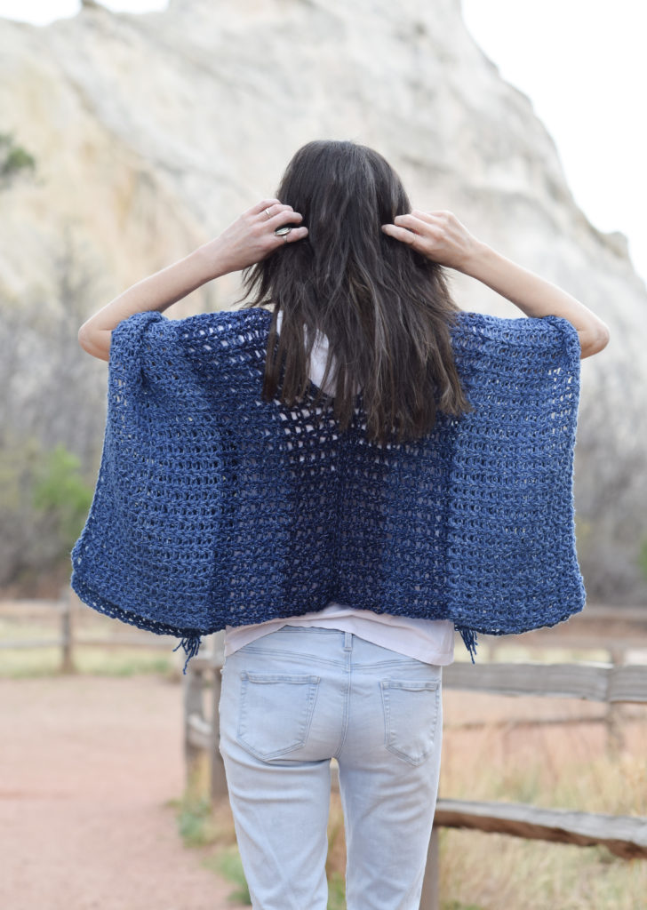 DIY navy V-neck crochet poncho (via www.mamainastitch.com)