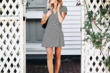 02 a black and white striped wrap mini dress with short sleeves and white sneakers for a comfy casual outfit