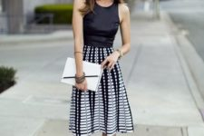 02 a black halter top, a black and white printed midi skirt and black suede sandals