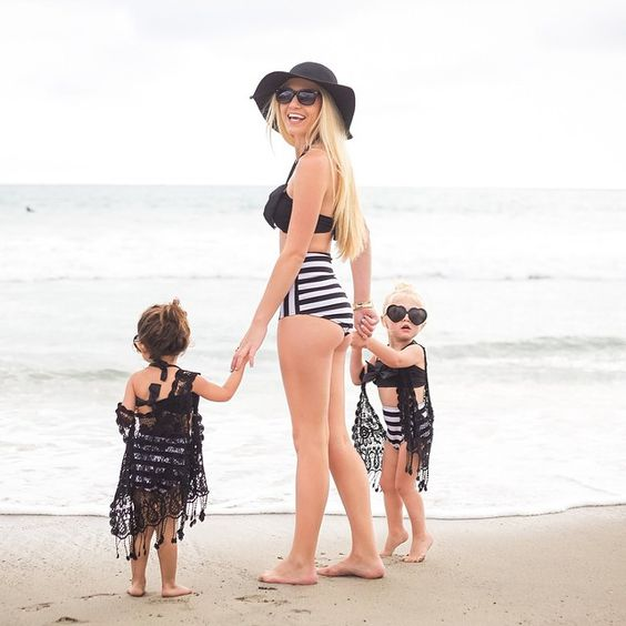 a black top and a high waist bottom swimsuits for the mom and her daughters