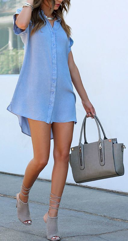 a blue shirt dress, grey suede lace up shoes and a grey bag