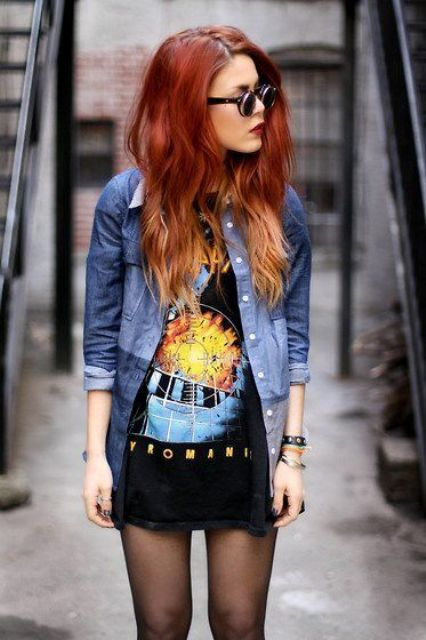 a bold printed oversized t-shirt, a denim jacket and bracelets
