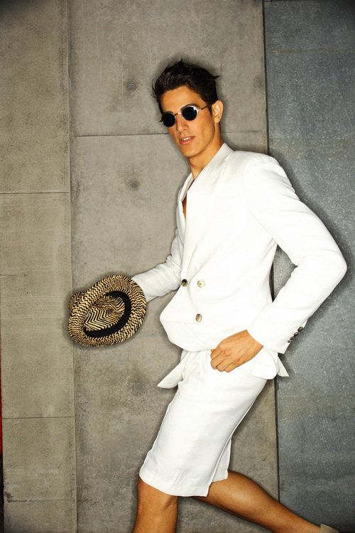 a white jacket, a white tee, white shorts and a hat by Giorgio Armani