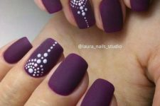 02 matte deep purple nails with accent ones with a tribal polka dot design