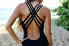 02 navy one-piece swimsuit with a strappy criss-cross back