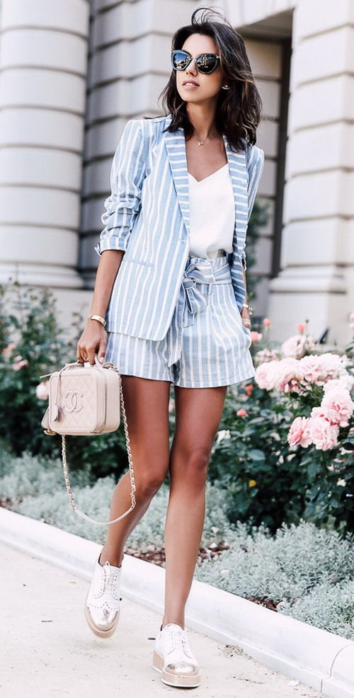 Picture Of A Blue Striped Shorts Suit With White V Neckline Top And Flat Shoes