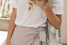 03 a blush wrap skirt with ties and white lace up shirt with short sleeves