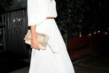 03 a flowy pleated white dress with wide half sleeves and a midi skirt, a clutch and nude ankle strap shoes