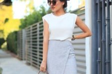 03 a grey mini skirt with a geometric design, a white sleeveless top