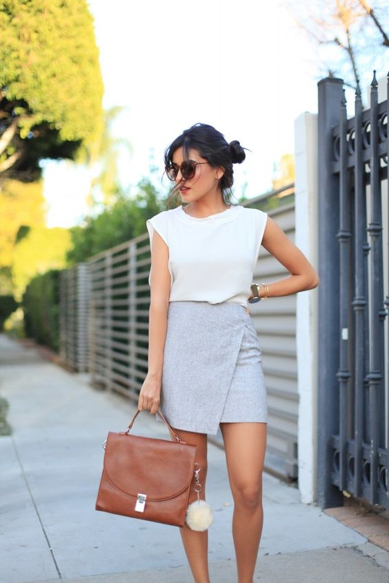 a grey mini skirt with a geometric design, a white sleeveless top
