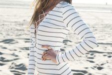 03 black and white long sleeve bathing suit with a front lace up